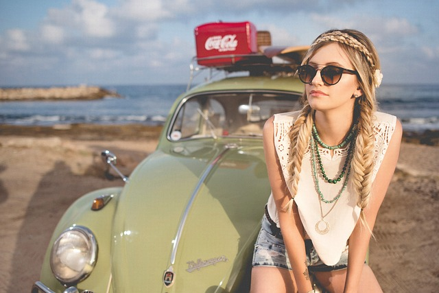 girl on vw beetle at the beach