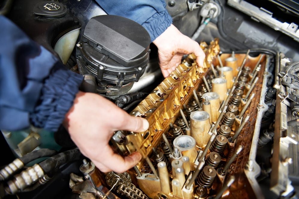 mechanic removing cylinder head